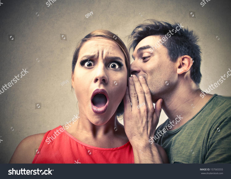 stock-photo-amazed-woman-listening-gossip-in-the-ear